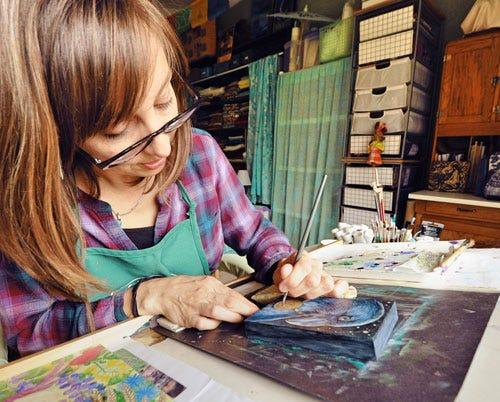 Ellen Paquette painting in her studio