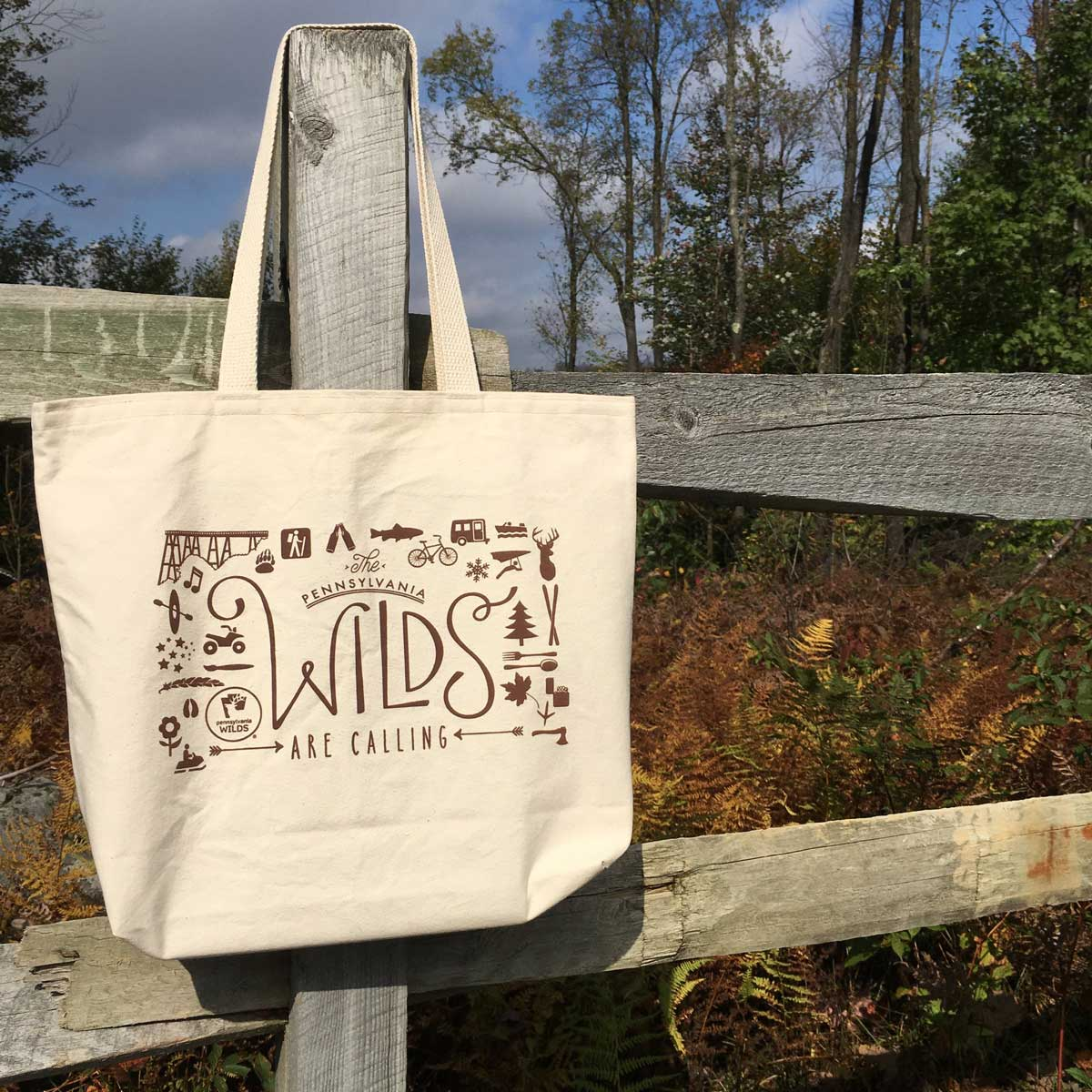 Wilds are Calling tote on a fence