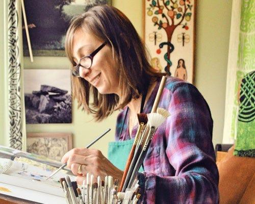 Ellen Paquette painting in studio